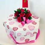Cup cake glore with possy and ribbon